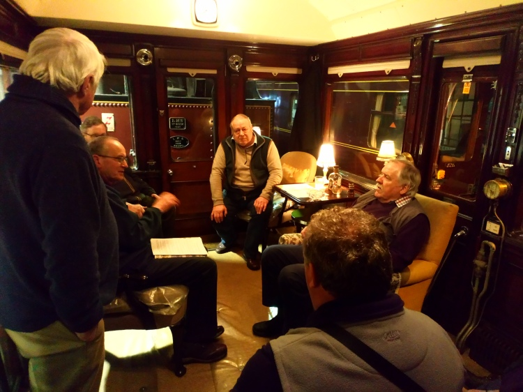 A group of visitors inside a railway carriage - Saloon 45000.
