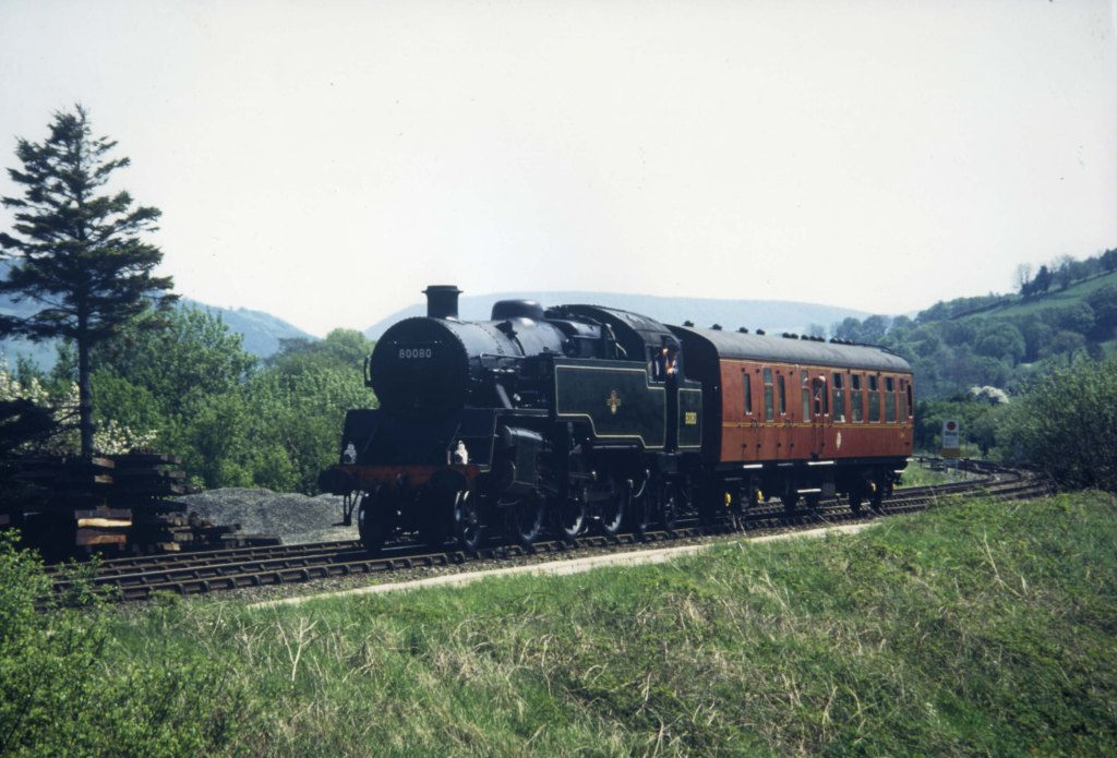 Steam locomotive 80080 travelling through the countryside