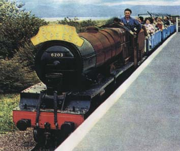 A miniature 21 inch gauge locomotive pulling a train of passengers at a Butlin's holiday camp