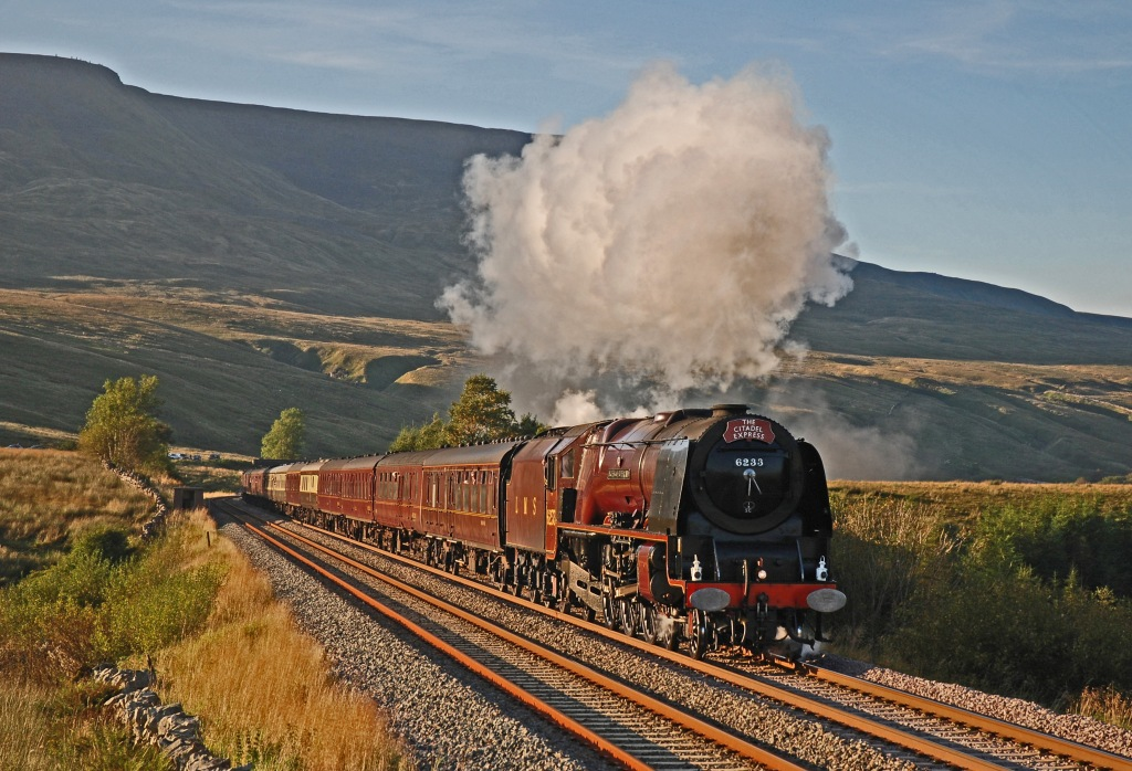 Steam locomotive Duchess of Sutherland travelling through the countryside