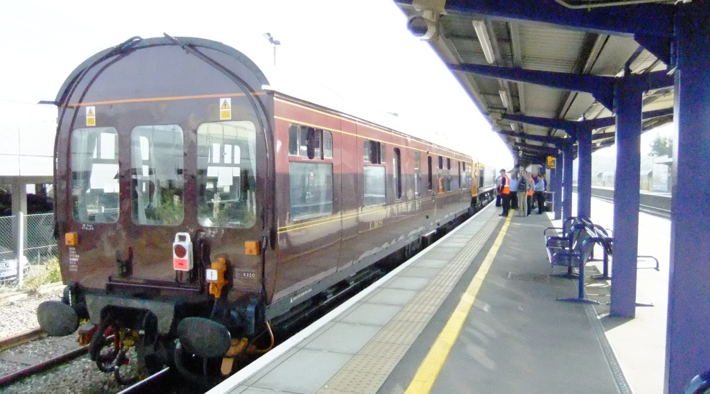 Railway carriage Inspection Saloon 6320 in a station platform