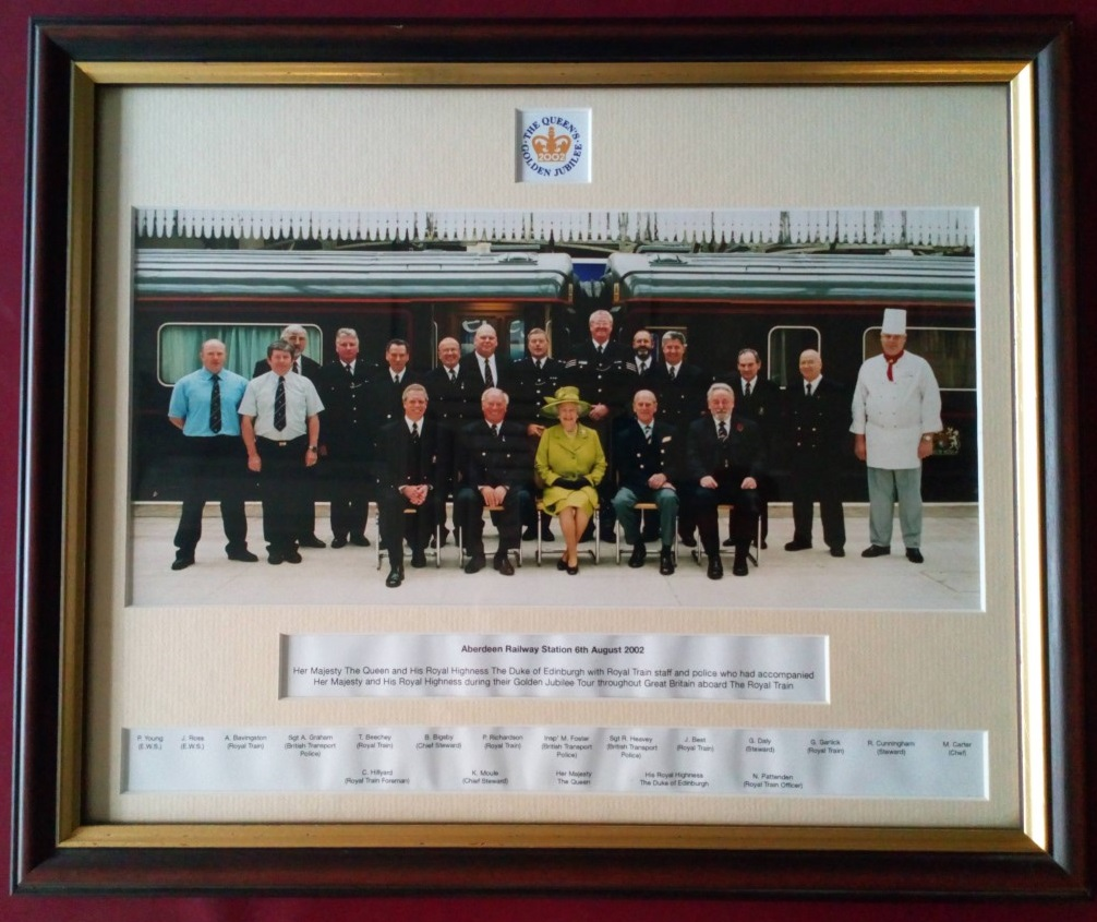 Royal Train staff and police with Queen Elizabeth and The Duke of Edinburgh.