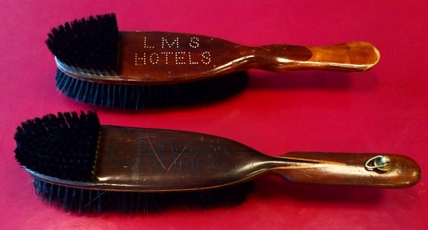 A clothes brush and shoe brush.