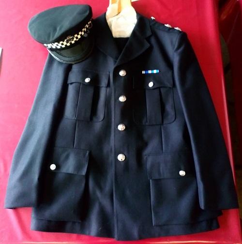 British Transport Police uniform jacket and cap.