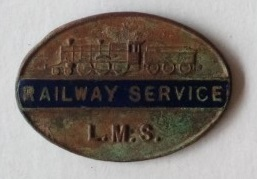 Oval metal badge featuring the words LMS Railway service and an engraved picture of a locomotive.