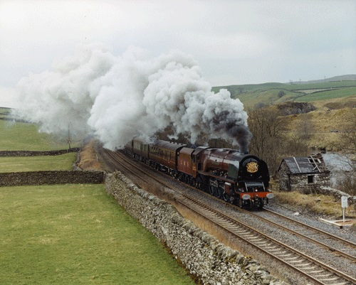 Steam locomotive Duchess of Sutherland pulling the Royal Train on the Settle - Carlisle railway 2005.