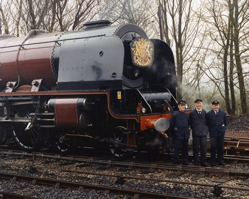 Footplate crew standing by steam locomotive Duchess of Sutherland ready to pull the Royal Train on the Settle - Carlisle railway 2005.