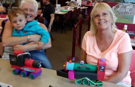 Visitors making model trains