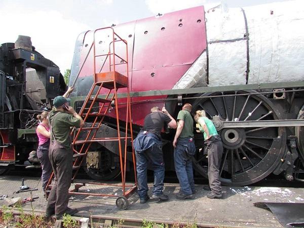 Volunteers working on the steam locomotive Duchess of Sutherland