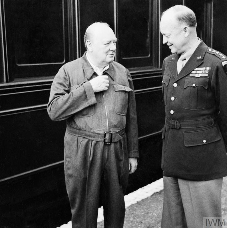 Winston Churchill and General Eisenhower talking next to a railway carriage during the Second World War
