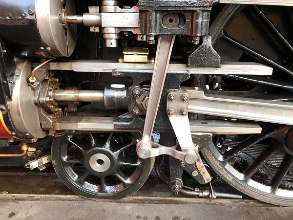 Close-up view of the wheels and motion of the steam locomotive Duchess of Sutherland.
