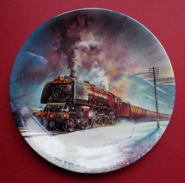 Pottery plate featuring a painting of the steam locomotive Duchess of Hamilton.
