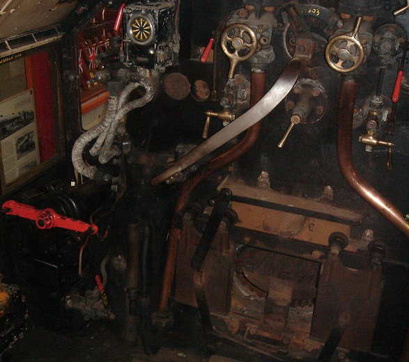 A view inside the driver's cab of a steam locomotive.