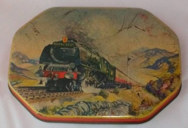 Metal toffee tin featuring a painting of the steam locomotive 46220 Coronation.