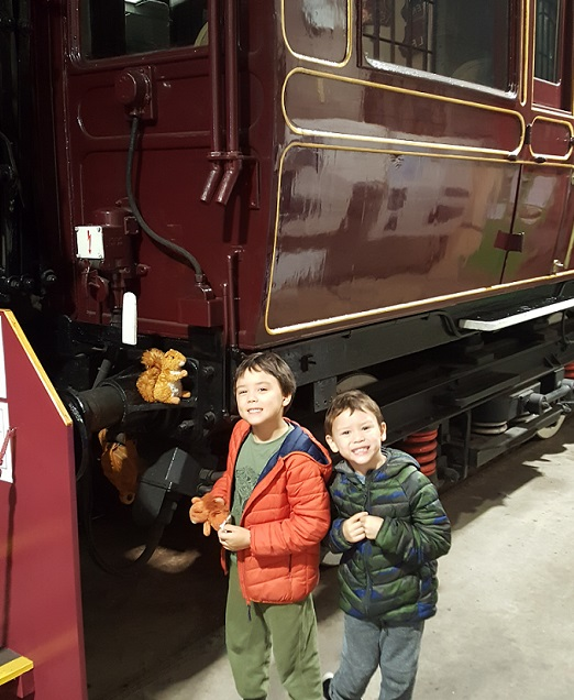 Young visitors standing by Saloon 45000